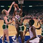 Rookie Charles Barkley shoots against Celtics Larry Bird and Robert Parrish. Barkley was taken with the fifth pick in the 1984 draft by the 76ers, joining a veteran team that had won the NBA title the year before.