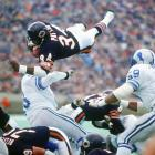 Walter Payton went around, through and sometimes over the defense to pick up precious yards.