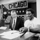 Bears president Mike McCaskey smiles at a press conference announcing Payton's three-year contract extension on May 8, 1984. Payton played his entire career in Chicago and rushed for a career high 1,684 yards the year he signed the extension.