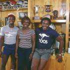 Walter Payton poses with his brother Eddie (left) and mother Alyne in his trophy room at home in Chicago on June 12, 1984.