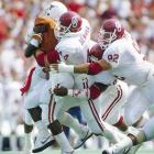 Bosworth tackles Texas' Darron Norris with help from some Oklahoma teammates.