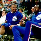 Charles Barkley smiles on the bench next to 76ers teammate Moses Malone at The Spectrum in Philadelphia. Barkley and Malone overlapped with the 76ers for two seasons, losing in the Eastern Conference Finals in 1985 and the conference semifinals in '86.