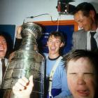 The Great One, who earned the Conn Smythe Trophy as playoff MVP, was joined in the jubilant Oilers' locker room by his father, Walter (right) after downing the Philadelphia Flyers in Game 5 at Northlands Coliseum in Edmonton. The Cup was the Oilers' second in a row.