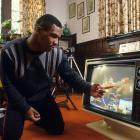 Mike Tyson watches video of a fight at the home of his surrogate mother Camille Ewald.