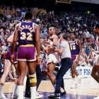 Charles Barkley has to be restrained as he gets into an altercation with Kurt Rambis during a game against the Los Angeles Lakers.
