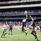 """Diego Maradona punches in the infamous """"Hand of God"""" goal against England in the 1986 World Cup."""