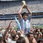 Diego Maradona hoists the World Cup to the sky as he's carried on the shoulders of his teammates following the conclusion of the 1986 World Cup final.