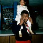 Actor Emmanuel Lewis is escorted around a bowling alley by Mike Tyson.