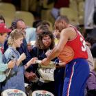Charles Barkley signs autographs for fans before a 76ers game against the Los Angeles Lakers. Although Barkley had one of his best statistical seasons, Philadelphia struggled that year, going 36-46 and missing the playoffs.