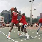Payton uses a hands-on defense against the Knicks' Patrick Ewing during a celebrity game at the Budweiser 3-on-3 Basketball Challenge in Chicago on July 9, 1988.