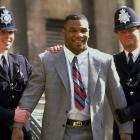 Metropolitan police collar Mike Tyson on a visit to London.
