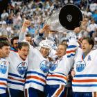 After vanquishing the Bruins in five games, Wayne Gretzky lifted the Cup for the final time as an Oiler, flanked here by (left to right) Bill Ranford, Esa Tikkanen, Mark Messier and Kevin Lowe.
