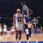 Charles Barkley stares down (or up) 7-foot-7 Manute Bol during a game against the Warriors. The two would later become teammates in Philadelphia.