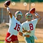 Future Hall of Famers Joe Montana and Steve Young loosen up during 49ers training camp at Sierra College in Rocklin, Calif.