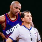 "Charles Barkley ""confers"" with an official during a game against Denver."