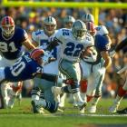 Dallas Cowboys running back Emmitt Smith escapes from Buffalo Bills safety Henry Jones at midfield. Smith led all rushers in the Cowboys 52-17 win, racking up 108 yards on the ground with a touchdown.