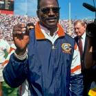 Payton shows off his Super Bowl ring during halftime of a Bears game against the Tampa Bay Buccaneers at Soldier Field in Chicago on Sept. 26, 1993.
