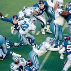 The Cowboys' Emmitt Smith ran into heavy traffic while the Giants' Lawrence Taylor tried to run into Smith.