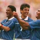 """Bebeto celebrates a goal in the 1994 World Cup with his now-famous """"baby cradle"""" celebration."""