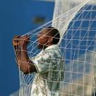 Rasheed Yekini celebrates in the goal netting after Nigeria scored its first ever World Cup goal,  against Bulgaria in the 1994 World Cup.