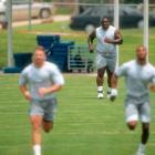 Dallas offensive lineman Nate Newton attempts to run sprints.
