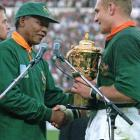 Mandela presents rugby team captain Francois Pienaar the William Webb trophy after South Africa defeated New Zealand 15-12 in the final of the 1995 Rugby World Cup. When Mandela handed the Cup to Pienaar he said, ''Thank you very much for what you have done for our country.'' Pienaar replied, Mr President, ''it is nothing compared to what you have done for our country.''