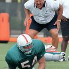Miami new head coach Jimmy Johnson drills rookie linebacker Zach Thomas during opening day of Dolphins' training camp in Davie, Fla.