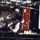 Joe DiMaggio and New York Governor George Pataki ride in a car together during the 1996 World Champion New York Yankees ticker tape parade in New York City.