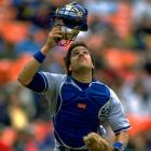 Mike Piazza looks to catch a pop-up during a game against the Giants in April 1996.