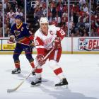 """Red Wings captain Steve Yzerman ended an epic goaltending duel by grabbing a puck off Wayne Gretzky's stick, taking off and beating Jon Casey with a slap shot from the blue line at 1:15 of double overtime. """"I couldn't believe it went in,"""" Yzerman said after the game. """"I don't score a whole lot of goals from out there. To score a goal in overtime, particularly in Game 7, is a tremendous thrill. Every player dreams of that."""""""