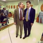 Peyton Manning talks with father Archie, himself a longtime NFL quarterback, immediately before announcing his decision to stay for his senior year at Tennessee. Manning was projected to be the No. 1 overall pick in the 1997 NFL Draft.