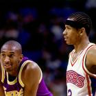 Kobe and Philadelphia's Allen Iverson chat it up during a game in 1997.