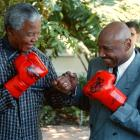 Boxing legend Marvin Hagler spars with Mandela. Hagler was in South Africa to be a commentator for a boxing tournament.