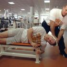 Peyton Manning his neck stretched by a trainer at Tennessee.
