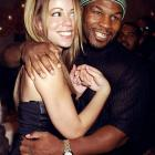 Mike Tyson hugs Mariah Carey during the opening of Sean ''Puffy'' Combs' new restaurant Justin's in New York City.
