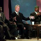 Jim Brown sits next to President Bill Clinton and wide receiver Keyshawn Johnson as Clinton talks during a town meeting on race and sports in Houston in 1998.