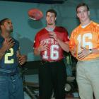(Left to right) Charles Woodson, Ryan Leaf and Peyton Manning toss a ball around prior to the 1998 NFL draft. Manning, who controversially lost out on the 1997 Heisman Trophy to Woodson, was the first selection of the draft, with Leaf going second to the Chargers.