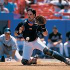Mike Piazza attempts to catch a throw to the plate in one of his first games with the Mets in May 1998.