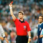 David Beckham receives a red card from referee Kim Milton Nielsen for kicking out at Diego Simeone during England's match against Argentina in the 1998 World Cup.  Argentina would eventually go on to win the match in a penalty shootout, drawing intense criticism from the English, who blamed David Beckham for dooming them.