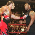 Mike Tyson gets a finger in the chest from wrestler Shawn Michaels during Wrestlemania XIV at the Fleet Center in Boston.