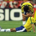 A dejected Ronaldo is consoled by Brazilian teammate Bebeto after France defeated the defending champions, 3-0, in the 1998 World Cup final.