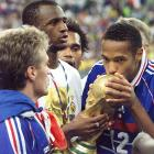 Thierry Henry kisses the World Cup trophy after France defeated Brazil, 3-0, to win the 1998 World Cup final on home soil.