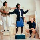 Peyton Manning helps Edgerrin James' mother Julie fit the Colts running back for a suit.