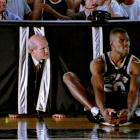 Bradshaw and San Antonio Spurs center David Robinson converse during the filming of a commercial scene for the New York Stock Exchange in 1999.