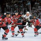 Sniper Brett Hull was trapped by New Jersey's notorious neutral zone defense during Game 3 in Dallas. Devils Sergei Brylin (18), Brian Rafalski (28), and Scott Stevens (4) did the honors here as Hull's Stars fell, 2-1.