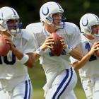 Colts quarterback Peyton Manning drops back with backup quarterbacks Pete Gonzalez (left) and Kelly Holcomb (right) during a drill at the teams' training camp in Terre Haute, Ind.