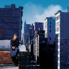 Mike Piazza sits on a rooftop near the World Trade Center disaster as a plume of smoke comes from the site where the Twin Towers would have stood on Sept. 16, 2001.