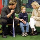 Mike Piazza sits with Brendan and Nancy Carroll, the son and wife of 9/11 fallen firefighter Mike Carroll, in Nov. 2001.