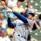 Green went 6-for-6 with an MLB record 19 total bases in the Los Angeles Dodgers' 16-3 rout of the Milwaukee Brewers.