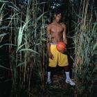A high-school aged LeBron poses during a Field of Dreams-inspired photo shoot.